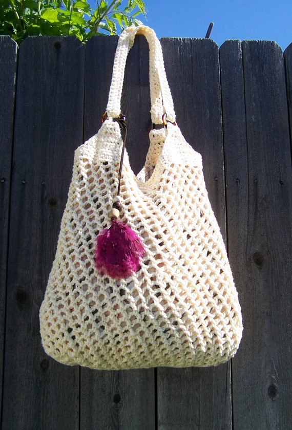 Items similar to Crochet Hobo Bag with Feather Beige