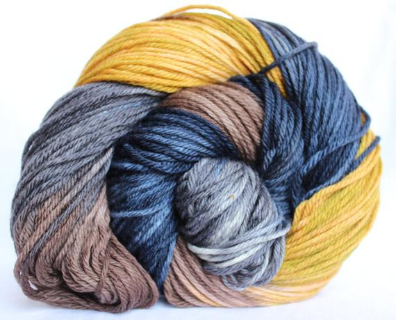 Items similar to Hand dyed yarn Blue brown yellow