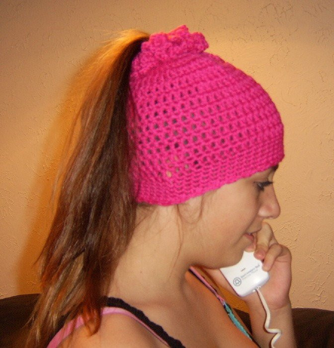 The Ponytail Hat stocking cap crocheted in Hot Pink