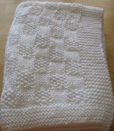 Awesome White Hand Knitted Baby Blanket In A Checkerboard Pattern for Hand Knitted Baby Blankets Of Gorgeous 42 Pics Hand Knitted Baby Blankets
