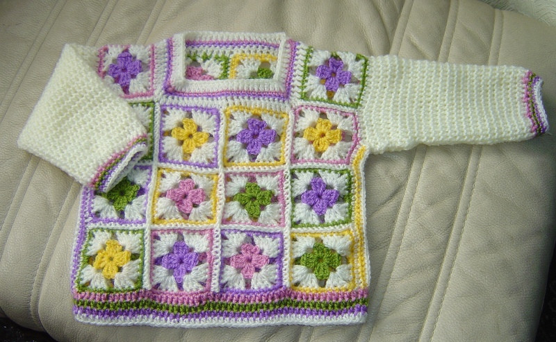Granny square sweater for a baby