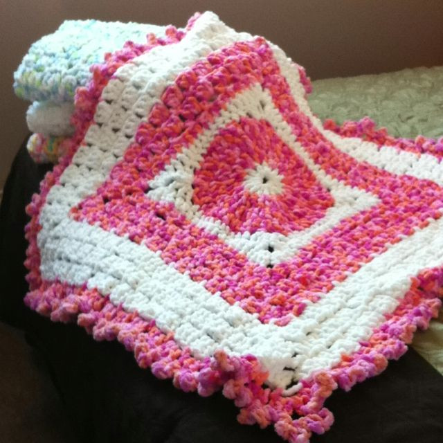 Baby blankets made with Bernat baby blanket yarn these are