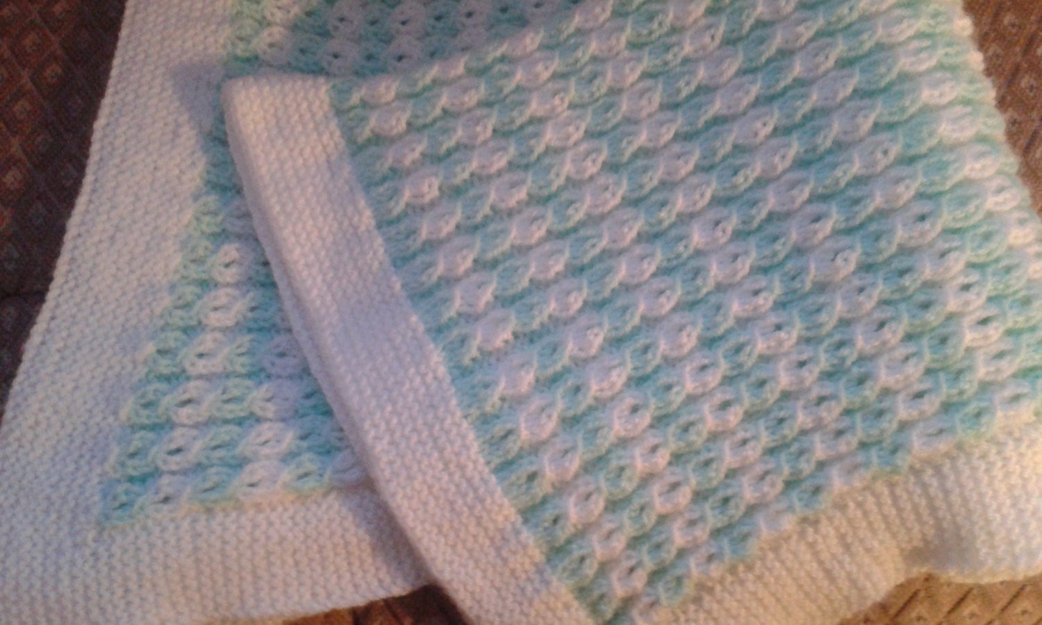 baby blanket hand knitted in mock cable