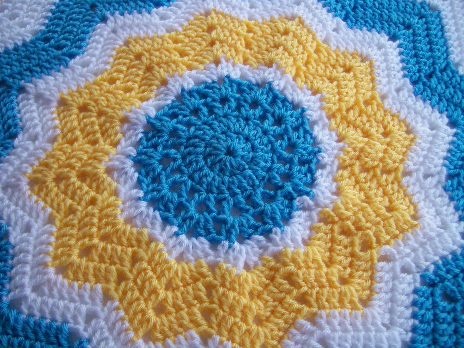 Crocheted Round Ripple Baby Afghan in Blue Yellow and White