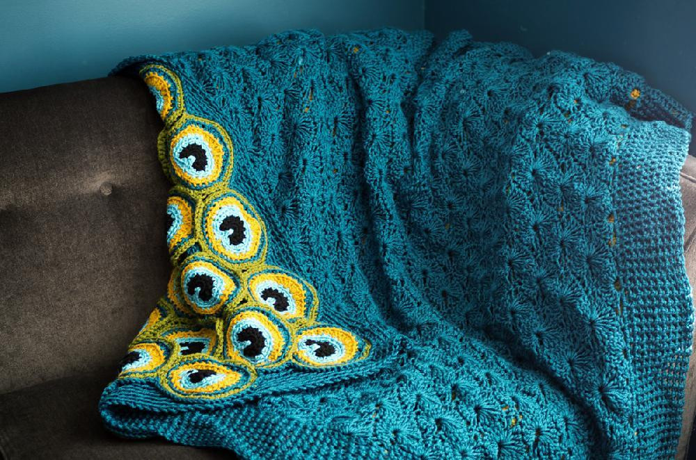editors inspiration a bright peacock blanket for the holidays