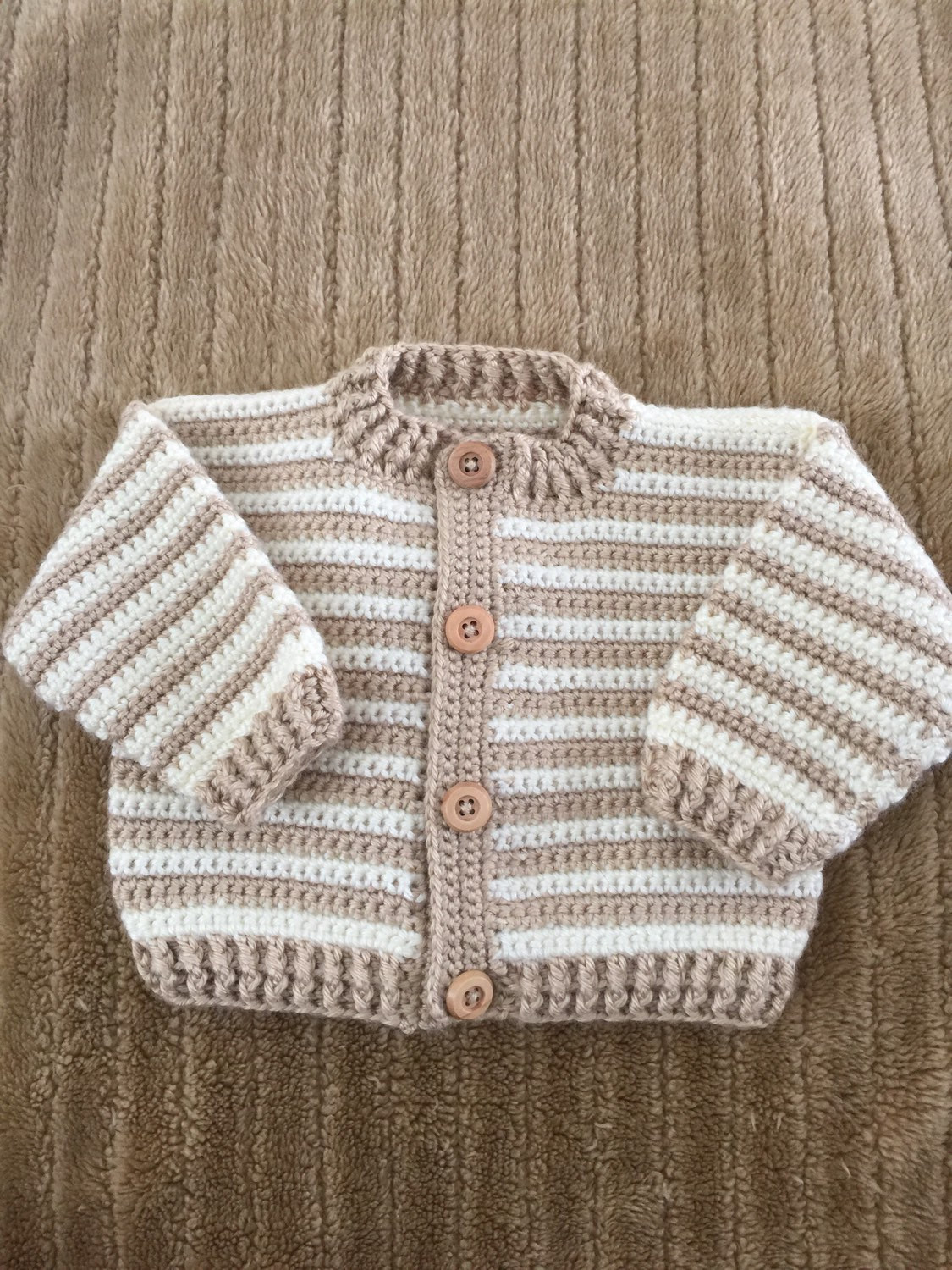 Crocheted baby boy sweater