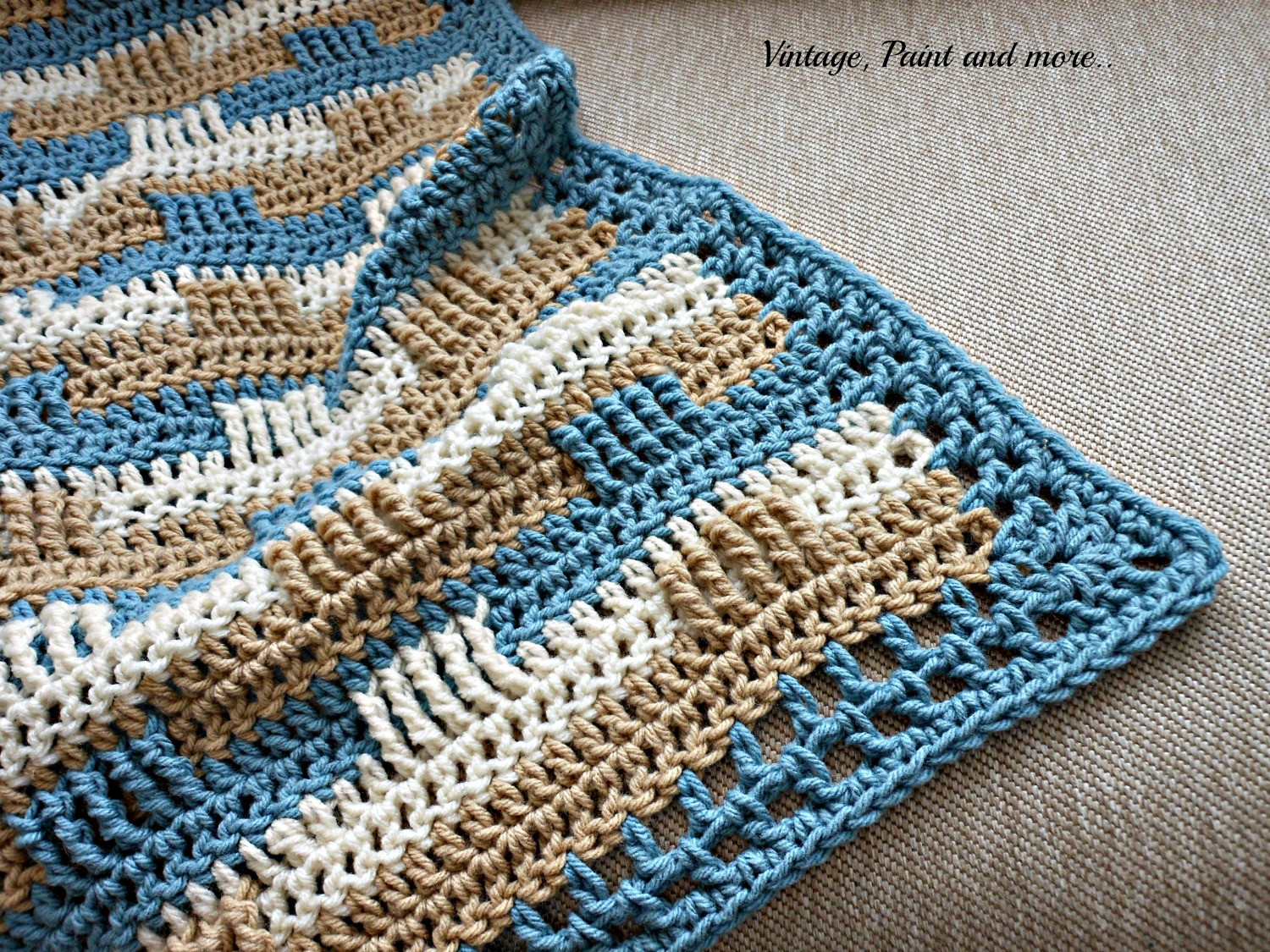 crochet afghan and stenciled pillow