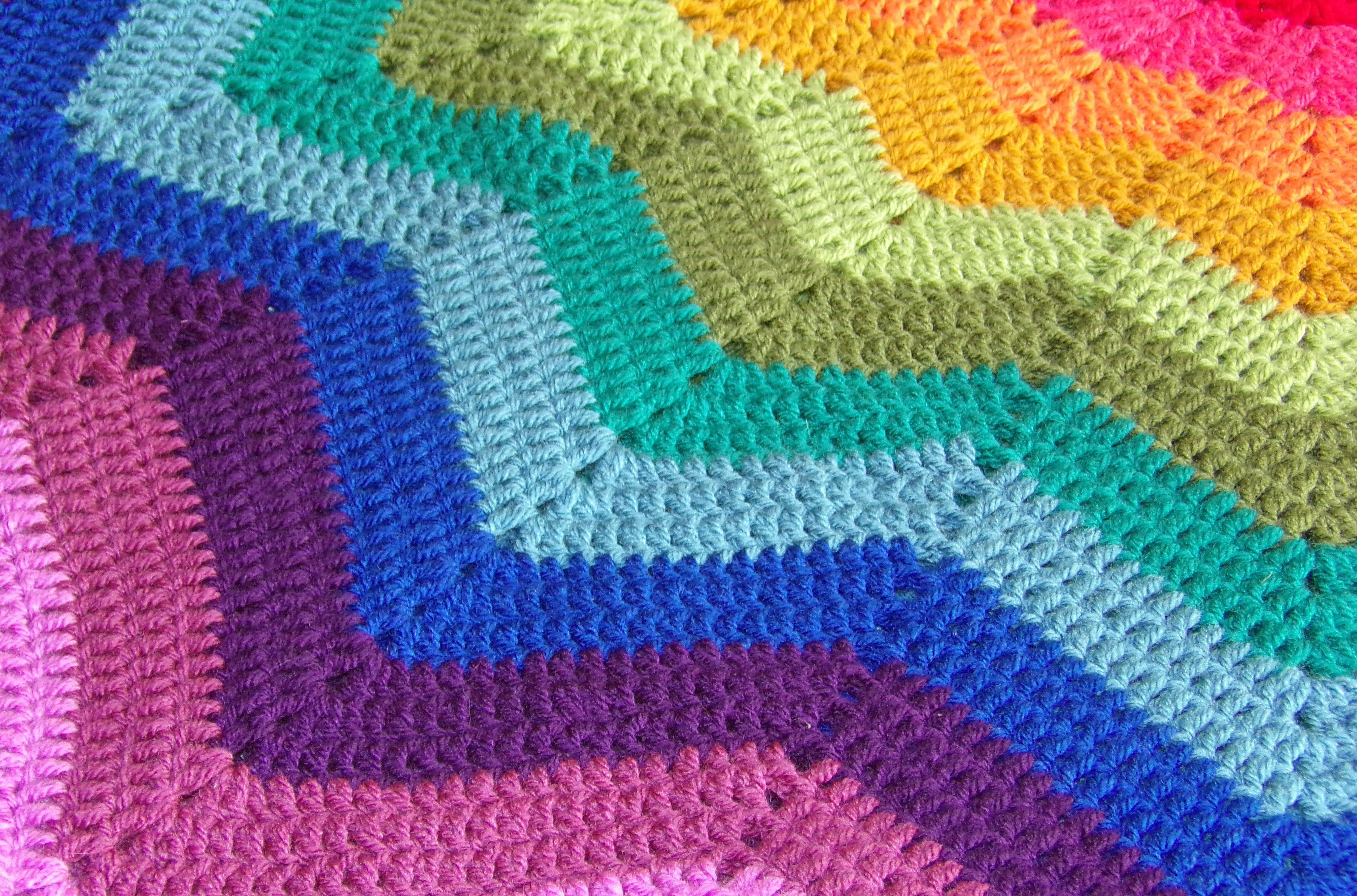 Crocheted rainbow ripple star blanket in all its