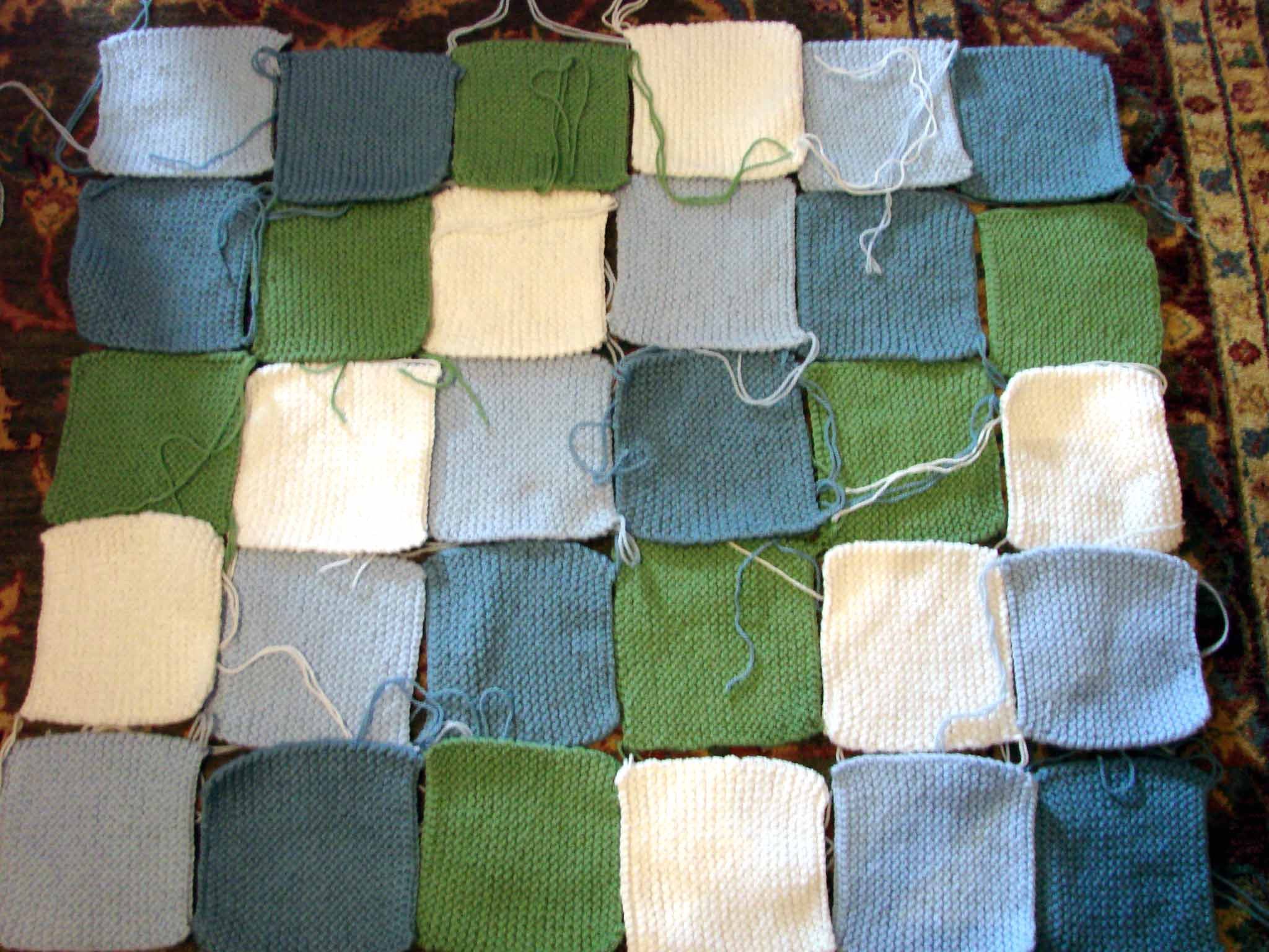 Knitted patchwork baby blanket…