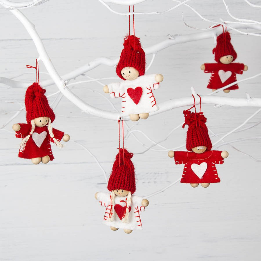 red and white mini christmas tree decorations by the