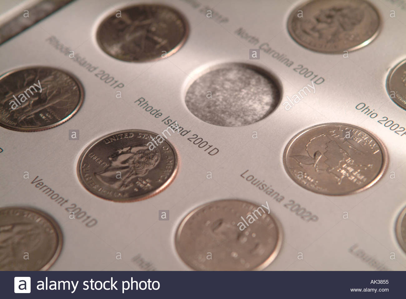 U S state quarters coin collection in book Stock