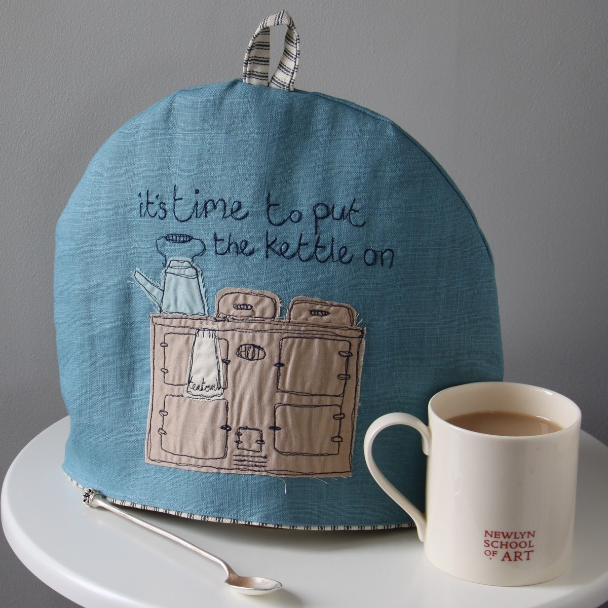 the good life tea cosy by poppy treffry