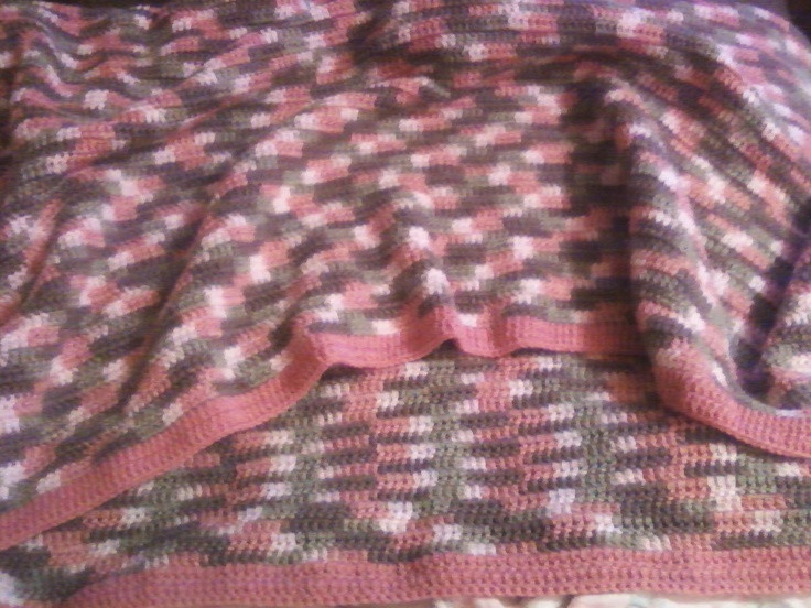 Pink camo yarn blanket Made for Embracing Hope Ministries